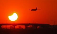Eclipse (Marc Rodriguez 24) Tags: red arizona sky orange sun moon phoenix set airplane solar eclipse fly us flying motorway pinkfloyd interstate states airways tempe 25mm airoplane darksideofthemoon f59 1160
