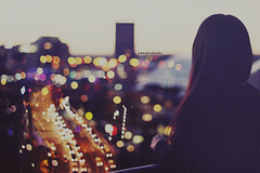Bright Lights in the Skyline Wont Let Me Lose My Way (Amanda Mabel) Tags: road city portrait sky colour girl skyline night hair 50mm lights back twilight view skyscrapers bokeh dusk balcony brightlights tinchystryder amandamabel brightlightsintheskylinewontletmelosemyway