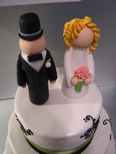 Hand-sculpted bride and groom cake toppers