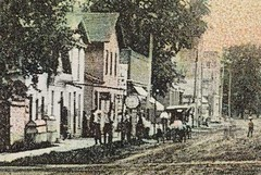 Main Street, Plainfield, Indiana, close-up section (Hoosier Recollections) Tags: houses people usa signs man color men history boys kids buildings walking advertising children awning indiana streetscene porch shops pedestrians storefronts residential businesses plainfield jeweler hendrickscounty hoosierrecollections