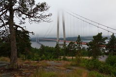 The Beautiful High Coast Bridge (Hgakustenbron) / North Sweden (entrance to UNESCO WHS High Coast) (Maria_Globetrotter) Tags: bridge mist fog canon day suspension cloudy sweden north unesco unescoworldheritage veda bron worldheritage whs dimma e4 hgakusten hga kusten highcoastbridge hgakustenbron 550d highcoast 1585 ngermanlven ngermanland vedabron