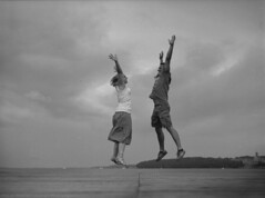 *FILM* jump for joy (Philip Schulze) Tags: couple woman man beautiful blackwhite schwarzweis water ostsee 120film mediumformat analog mamiya645 ilford fp4plus 125asa rodinal 150 sekor80 film jump freedom