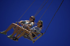 Swinging (swong95765) Tags: swing ride girls females fun amusement hanging chain sky