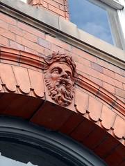 Cheerful Brick Man (the justified sinner) Tags: justifiedsinner carved brick stone face greenman terracotta victorian wales welshpool panasonic leica elmarit macro 28 45mm gx7