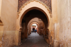 Arches of the Medina (Cagsawa) Tags: medina benyoussefmadrasa benyoussef madrasa archway alleyway bike biker pedestrian marrakech marrakesh morocco moroccan africa african islam muslim tile pattern art rx100 souk alley street