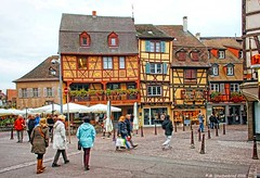 A town square with half-timbered houses in Colmar France (PhotosToArtByMike) Tags: colmarfrance colmar france alsace halftimbered cobblestonestreets littlevenice medievalcity oldtown medievalstreets alsatianvillageofcolmar hautrhin townsquare