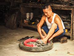 tyre fixer copy (anwoody) Tags: approved xingping china guano people streetlife