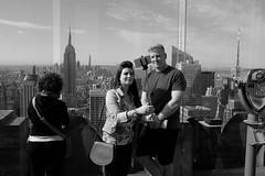 Top Of The Rock Selfie People 5 (andyfpp) Tags: fuji fujifilm x100t newyork nyc newyorkcity blackandwhite bw bwred mono monochrome monotone selfie stick iphone rock topoftherock shadows rockefeller