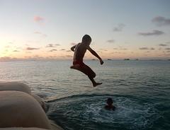 Swimming Jump (mikecogh) Tags: tuvalu funafuti jumping sea fun daring friends boys swimming