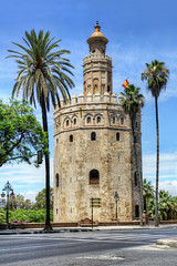 Torre del Oro in Seville (chrisdingsdale) Tags: tower seville torre torredeloro goldentower goldtower andalusia spain architecture watchtower oro fortification medieval arabic stone round landmark andalucia andalusian spanish sevilla military historic placeofinterest touristattraction historicalbuilding palmtrees monument vertical moorish old fortress prison middleages dodecagonal
