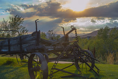 Wedding Sunset on Wagon (aaronrhawkins) Tags: alpineartcenter reception clouds art antique farm golden light sundown scenic grass hills mountains colorful purple aaronhawkins sunbeams twilight evening alpine utah