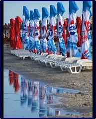 Last days of season at Black Sea (Ioan BACIVAROV Photography) Tags: blacksea sea water autumn season bacivarov ioanbacivarov bacivarovphotostream interesting beautiful wonderful wonderfulphoto nikon umbrella reflection reflections colorful red blue