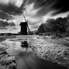 Bidston Windmill Mono (Halstead Photographic) Tags: longexposure sky cloud reflection building tree water windmill silhouette canon mono rocks si wideangle hills wirral merseyside farscape halstead biston