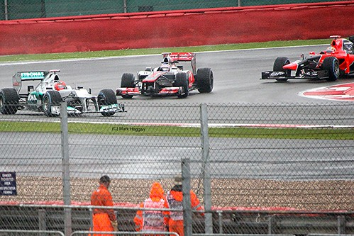 Jenson Button and Michael Schumacher at Silverstone