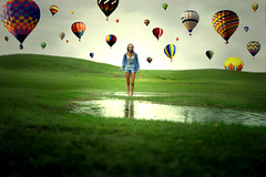 As Balloons Go By (Izzy Guttuso) Tags: summer storm reflection water colors girl field rain photoshop puddle 50mm rainbow florida vibrant surrealism sony horizon balloon young surreal montage f18 dslr raining ballons hotairballoons