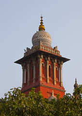 One Tower Of The Madras High Court Of Judicature In Chennai, India (Eric Lafforgue) Tags: red india colour bird outside outdoors photography day madras victorian bluesky nobody nopeople indie vegetation copyspace chennai indi indien hind tamilnadu indi clearsky redtower inde hodu indland  hindistan embrasure indija   traveldestinations exteriordecoration ndia hindustan madrashighcourt 6496 buildingexterior  victorianstyle    hindia builtstructure  crownoftrees bhrat  indhiya bhratavarsha bhratadesha bharatadeshamu bhrrowtbaurshow  hndkastan       colorfultower buildingofarts decoratedbulding peakonthetop upperpartoftrees vegetationonabuilding