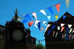 Olympic Bunting at Much Wenlock (Heaven`s Gate (John)) Tags: blue england sky sunlight london clock square town shropshire market games flags olympic 2012 muchwenlock williampennybrookes johndalkin heavensgatejohn