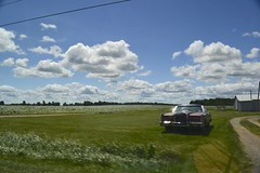 cars and clouds and driving by (ktLaurel) Tags: road old summer usa newyork car clouds vintage landscape drive blurry colorful zoom upstate roadtrip voiture route ciel fields passing blueskies t nuages