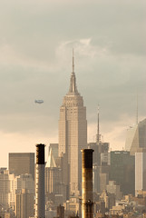 Zeppelin and the Empire State Building (Guillermo Murcia) Tags: newyorkcity sunset newyork beautiful skyline skyscraper flying manhattan air bank landmark aerial transportation empirestatebuilding gotham iconic urbanism flyover verticality capitaloftheworld guillermomurcia