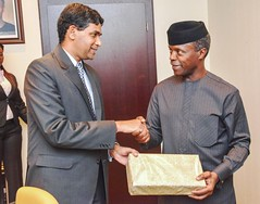 Vice President Prof. Yemi Osinbajo SAN was being presented with a gift by Mr. B.N. Reddy India High Commissioner during his courtesy visit