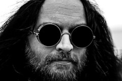 Dark sunglasses (I am still alive) Tags: black white dark sunglasses man beard face hair lines detail canon camera portrait close tight person nose eyes manly handsome round john lennon look like photoshop adobe lightroom oliver parsons ollie flickr digital grain noise england london uk headshot head shot weekend