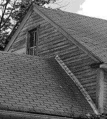 Face In The Attic Window (Kris_wl) Tags: oldhouse attic atticwindow face ghost ghostface house blackandwhite bw monochrome farmhouse spooky haunting paranormal texture roof