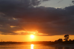 The sun sets over the Manasquan River and the Fisherman's Cove Conservation Area (apardavila) Tags: clouds fishermanscoveconservationarea jerseyshore manasquan manasquaninlet manasquanriver sunset