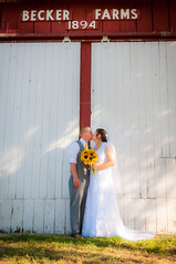 Megan And Justin Kiss Under Red Backer Farms (R P M Photography) Tags: justin megan clark mrs mr becker farms wedding raechelle hollingsworth r p m rpm photography pretty beautiful gorgeous lace sunflowers