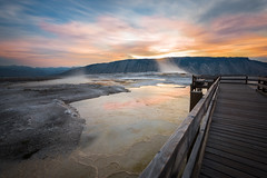 Sunrise at Mammoth Hot Springs (Tom McAdam) Tags: sky sunrise clouds colors sun boardwalk mountains long exposure nature hot spring yellowstone national park steam mammoth wyoming morning travel water reflection exploration d610 rocks hdr nikon p
