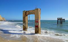 Davenport Pier, Davenport, California (fcphoto) Tags: davenport pier beach cliff sea pacificocean sunny wave surf blue sky california fcphoto arch gate swing hdr