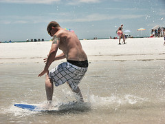Skimming The Surface (Vic Romn) Tags: skimboarding skim skimming surf sand beach sun ocean playa fort de soto park