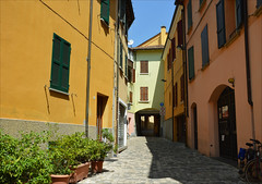 Cesena (angelsgermain) Tags: street cobbled houses windows flowerpots plants passageway colours sun shadow noon summer cesena histpriccitycenter emiliaromagna italia italy