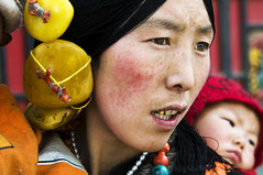 TIBET (BoazImages) Tags: family portrait woman baby face asian colorful asia faces traditional culture documentary tibet ornaments aba tradition eastern