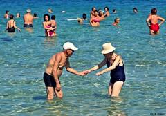 Tenerezze..... (supervito) Tags: italia mare sole palermo spiaggia sicilia cocco capaci ombrellone ciambelle isoladellefemmine extracomunitari bagnanti venditoriambulanti terzaet tipidaspiaggia