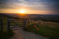 (drfugo) Tags: light sunset grass clouds fence landscape sussex wire gate contrail path meadow hills flare barbedwire canon5d footpath grazing lewes firle southdownsway fartoomanytags firlebeacon westfirle sigma28mmf18exdg ranscombehill timetostepbackandnotprocessasmuch
