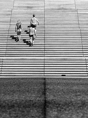 Girls on Stairs (Jason Gallant.) Tags: girls summer bw lines stairs canon eos pattern sfu symmetry simonfraseruniversity linear 18200mm 60d