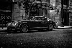 Bentley Continental GT (pillarsoflight) Tags: city blackandwhite bw white black apple monochrome beauty wall oregon silver portland awning prime grey nikon imac 28mm bricks spokes wheels gray performance continental pole adobe pacificnorthwest pdx nik desaturated 28 grille gt visitor pnw coupe bentley sandisk lightroom crop apsc filmlens d3300 sensor shotonsandisk classicaperture