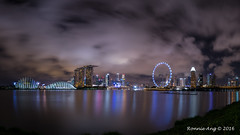 Nightscape of the Singapore City Skyline. (ronang) Tags: marinabayskyline marinabay singaporeflyer nightscape sea smooth reflections clouds movingclouds gardensbythebay singaporenightphotos singapore benjaminshearesbridge marinabaysands night dramatic smoothreflections smoothsea