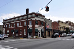 Around the block (Jake (Studio 9265)) Tags: bardstown ky kentucky usa united states america outdoor photography corner store street traffic light red american flag cross walk intersection cars van road building structure