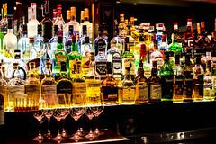 bar is open (-gregg-) Tags: bar bottles glass wedding mirror low light
