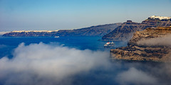 Cruise Away (Ron Scubadiver's Wild Life) Tags: ship sea clouds cliffs landscape santorini greece nikon 24120