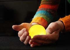 Glowing ball (Helen in Wales) Tags: light selfportrait yellow week18 hands glowing lowkey selfie balloflight t189522012week18