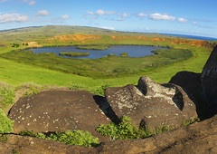 Lying Moai Over Rano Raraku Lake, Easter Island, Chile (Eric Lafforgue) Tags: chile sculpture sunlight lake color colour archaeology latinamerica southamerica grass statue rock horizontal landscape outdoors photography volcano nationalpark day exterior pacific nobody nopeople unescoworldheritagesite unesco worldheritagesite fallen geology lying moai easterisland scenics colorphoto rapanui layingdown tranquilscene isladepascua hangaroa tribalart ranoraraku archeologicalsite volcaniccrater humanhead singleobject southpacificocean traveldestinations internationallandmark ancientcivilisation lyingonback physicalgeography malelikeness polynesianisland southamericanculture rapanuinationalpark anthropomorphicface southeasternpacificocean polynesiantriangle chileanpolynesia ranoaraku