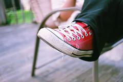 Red Chucks (alanabramsphotography) Tags: color slr film 35mm fuji superia olympus converse 400 sneaker vivitar allstar om1 chucktaylor tennisshoe xtra