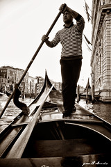 Slowly Does It (daviesg) Tags: venice blackandwhite bw italy man sepia persona boat italia ride stripe oar gondola tradition venecia venezia