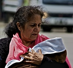 A grandmother's dream (Alejandro Erickson) Tags: street baby grandmother candid indian