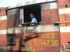 The Train & The Train Man (A Kamal Khan) Tags: road street door city blue windows sky people cloud india house building bus tree cars tourism home window up field station rural train garden town coach asia tour village traffic farm indian hill platform rail railway junction huts hut mango driver motor express khan char residence bagh hilly quarters charbagh ganga sleeper lucknow kamal baugh gomti sultanpur chaar motorman pushpak uttarpardesh musafirkhana abkamalkhan isauli