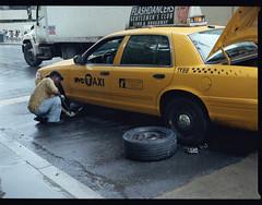 Manhattan #2 (ChrisAbe1226) Tags: city people urban blackandwhite bw ny newyork color monochrome car rain composition mediumformat photography manhattan taxi streetphotography dailylife pentax645 collegework kodakportra illfordhp5 highschoolwork chrisabe1226 chrisabrahamsen