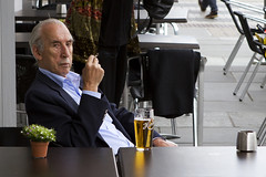beer and cigarette (Magne M) Tags: old people man flower beer caf norway outdoors restaurant cigarette candid bergen ashtray godfather laidback peopleinthestreet alligned