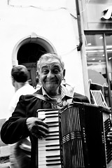 accordian (mhodges) Tags: blackandwhite bw italy musician music florence nikon outdoor restaurants seating accordianplayer d700 2470mmf28g nikon2470mmf28gedifafs